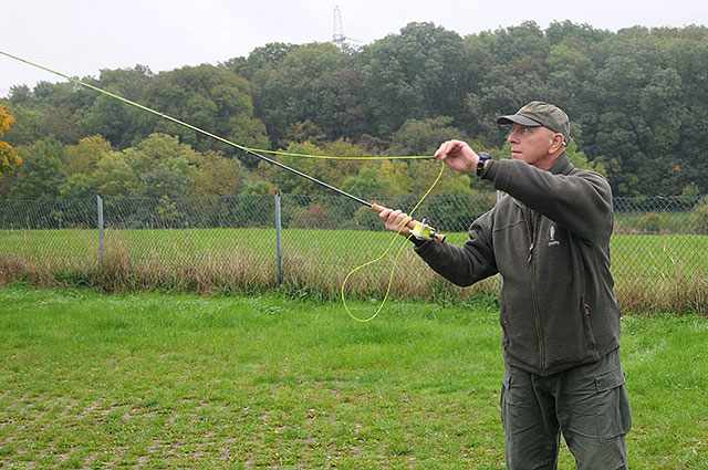 Close up of Andy Hathaway practising casting